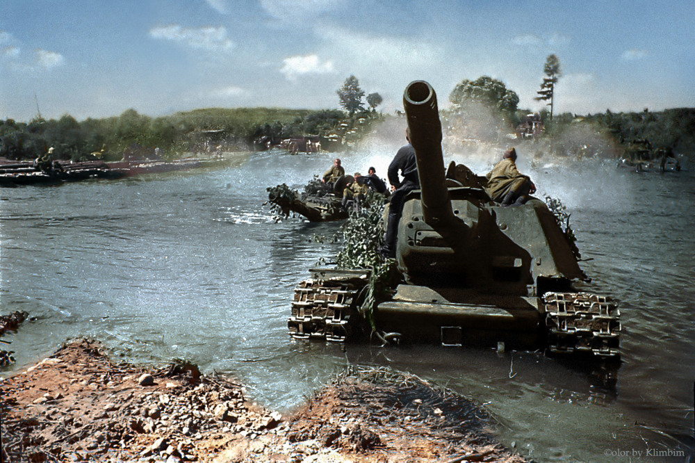 heavy-tanks-of-soviet-troops-advance-west-along-the-forest-roads-of-latvia-forcing-water-barriers-1944.jpg