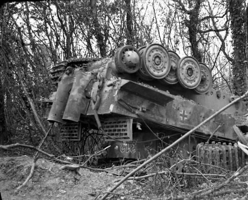German-PzKpfw-VI-Tiger-tank-overturned-during-the-Allied-heavy-bombing-at-the-beginning-of-Operation-Goodwood-July-1944.1.jpg